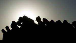 Soldiers-from-Task-Force-3-66-Bravo-Company-of-the-172-Infantry-Brigade-bow-their-heads-during-a-prayer-to-remember-the-victims-of-911-before-a-ceremony-at-Forward-Operating-Base-FOB-Kushamond-on-September-11-2011.-Johannes