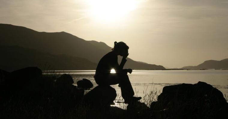 14458-woman-praying-lake-water-sun-light-silhouette-wide.1200w.tn